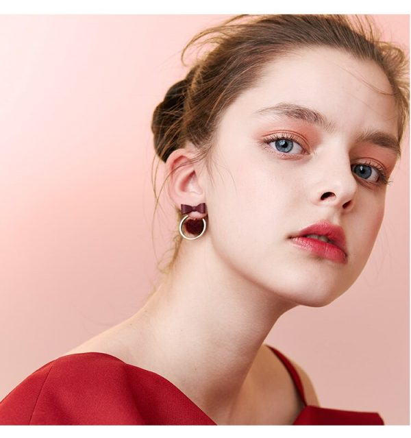 31508 e2be79 600x639 - AOMU Red Pompon Ball Stud Earrings Set For Women Girl Brincos Circle Star Fluffy Fur Ball Bowknot Earrings New Year Gift